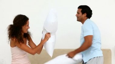 Man and woman having a pillow fight — Stock Video