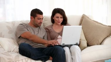 Couple looking at the computer — Stock Video