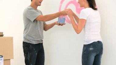 Nice couple paiting a wall — Stock Video