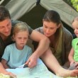 Cute family camping in the countryside - Stock Photo
