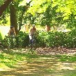 Athletic young couple going cycling in a wood — Stock Video