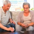 Stock Video: Mature couple playing cards