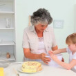 Stock Video: Grandmother with her granddaughter baking