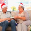 Mature couple during the Christmas day — Stock Video