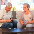 Stock Video: Couple playing cards
