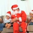 Santa Claus with an happy family — Stock Video