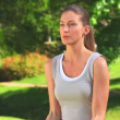 Woman excersising with dumbbells outdoors — Stock Video