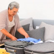 Elderly woman preparing her luggage — Stock Video