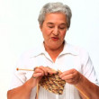 Stock video: Elderly woman knitting