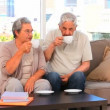 Retired couple drinking a cup of tea — Stock Video