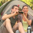 Couple camping in the country side - Stock Photo