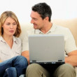 Lovely couple using a laptop — Stock Video #15535031