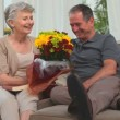 Cute elderly couple with a bunch of flowers — Stock Video