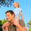 Father  with his son on his shoulders - Stock Photo
