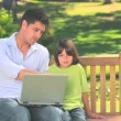 Father and son with laptop outdoors - Lizenzfreies Foto