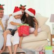 A family during Christmas - Stock Photo