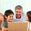 Stock Video: Family with a laptop
