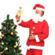 Santa Claus decorating the Christmas tree — Stock Video #15539597