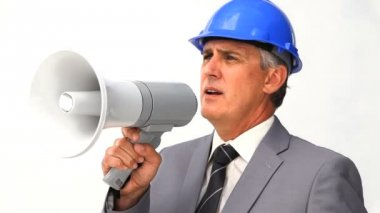Chief of a building project using a megaphone — Stock Video