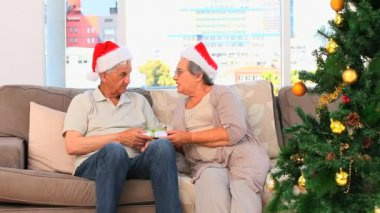 Woman offering a present to her husband