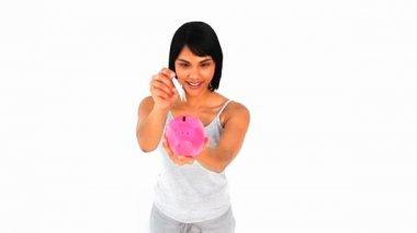 Asian woman saving money on a piggy bank — Stock Video