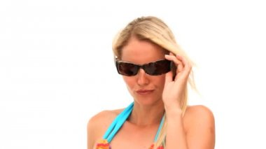 Attractive blonde woman removing her sunglasses — Stock Video