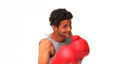 Handsome man with red boxing gloves — Stock Video