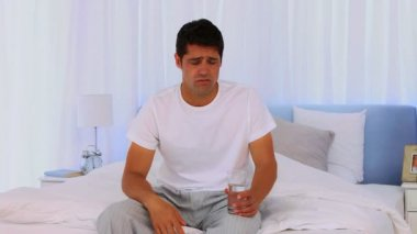 Man taking an aspirin during the morning — Stock Video