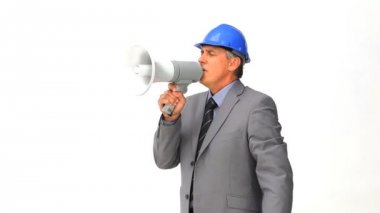 Architect giving orders through a megaphone — Stock Video