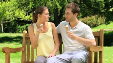 Happy couple enjoying their ice creams — Stock Video