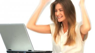Happy woman looking at her laptop — Stock Video