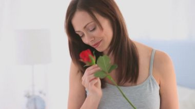 Woman smelling her rose — Stock Video