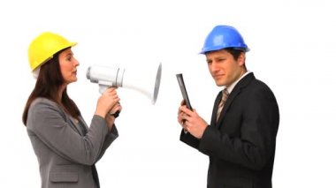 Business with safety helmets and megaphone — Stock Video