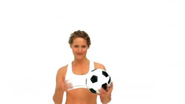 Cute woman holding a soccer ball — Vídeo de stock