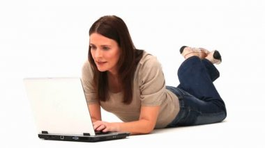 Brunette laying with a laptop — Stock Video