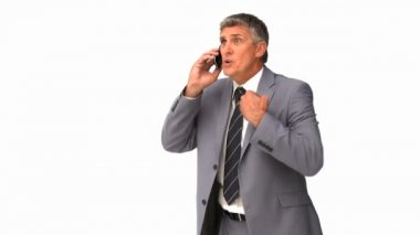 Businessman getting nervous on phone — Stock Video