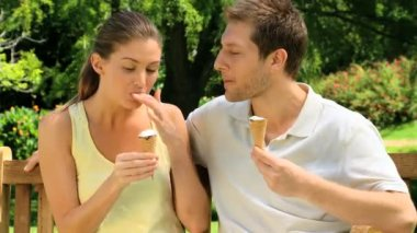 Cute couple eating ice creams — Stock Video