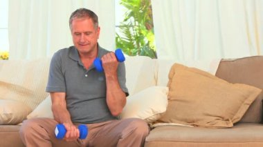 Dynamic male with dumbbells — Stock Video