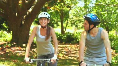 Athletic couple cycling in a wood — Stock Video