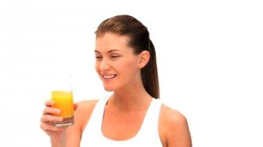 Woman drinking a orange juice — Stock Video