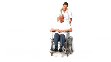 Nurse with her male patient in wheelchair — Stock Video