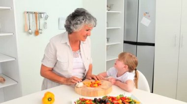 Attentive Grandmother cooking with her granddaughter — Stock Video