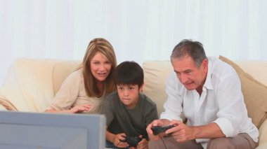 Grandparents playing video games with their grandson — Stock Video