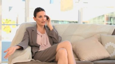 Businesswoman taking a phone call — Stock Video