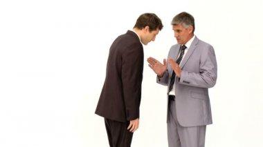Affärsman som ger en förklaring till hans medarbetare — Stockvideo