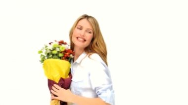 Cute blonde woman with a bunch of flowers — Stock Video
