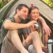 Loving couple camping in the country side — Vídeo de stock