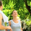Stock Video: Couple taking rest after jogging