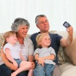 Family taking a photo about themselves — Stockvideo