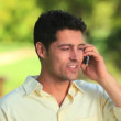Happy man on mobile phone - Stock Photo